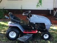 it is a wizard riding lawn mower runs great has a 42 in
