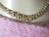 Beautiful NEW never worn Gold and Diamond Necklace.