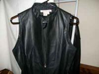 Womans leather shirt/vest has a tie around the waist,
