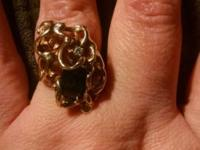18 karat gold ring size 9 with diamond chips and a dark