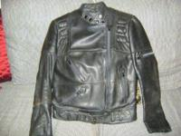 Sporty woman's black very nice leather motorcycle