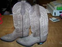 We have a set of Tony Lama females's boots size 6 for