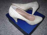 I have for sale a pair of Novela slip on heels, womens