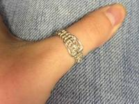 Sterling Silver Buckle ring. It is beautiful, has a