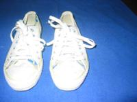 Pair of women's Converse All Stars. They are white with
