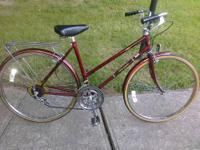 A deep red color, this bike has cruiser style handle