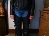 Women's black leather motorcycle coat with fringe. Size