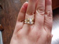Ladies size approximately 8 to 8 1/2 ,round solitaire ,