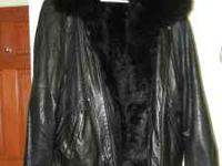 "Black python leather ""biker style"" coat with fur lining"