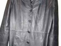 Size medium. 100% genuine leather. Black. Used, but in
