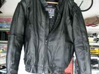 FOR SALE IS A WOMAN'S BLACK LEATHER MOTORCYCLE JACKET.