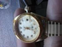 Lady's gold date just watch.it runs great and is water