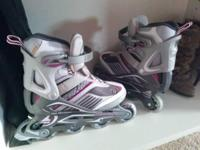 Purple, white, and grey Size 8 Women's Rollerblades