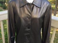 Ladies Soft black leather jacket, NWOT, side slits,