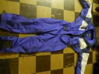 Purple and White women's snowsuit in size 10. Has one