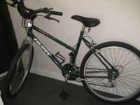 Dark green Huffy 10 speed womens bike. Brand new back