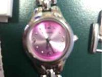 Womens Fossil watch, needs battery, comes with original