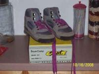 One pair of womens size 8 hiking shoes or boots. These