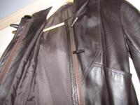 Amazing Womens Leather trech coat. Worn a couple of