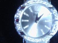 BEAUTIFUL LADYS WATCH, HAS DIAMONDS ON THE BEZZEL, AND