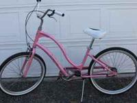 Pink womens Townie, 3 speed. Pedal forward design,