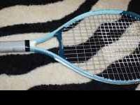 Wilson light blue/light green womens tennis racket.