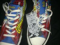 These are never worn Wonder Woman converse in size 10.