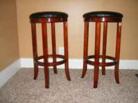 Cherry stained wood stools with black leather swiveling
