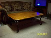 I am selling a wood top coffee table.  The legs are