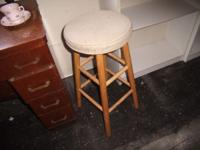 This is your typical bar stool with a beige cushioned