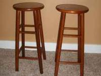 Cherry stained wood bar stools. In good condition.