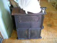 sears & robuck cast iron wood burning stove. in very