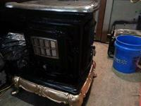 Nice old wood burning parlor stove, this stove has the