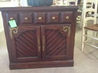 medium size wood cherry cabinet with drawer and doors