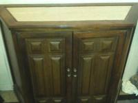 I have a nice wood cabinet for sale. It has a shelf