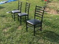 3 black wood chairs for $10. Some tears in cushions. .