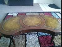 this is an older wooden coffee table, it has the