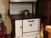 1900-1910 wood cook stove. white with bun warmer on