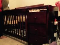 Wood crib with attached changing table Includes: -bed