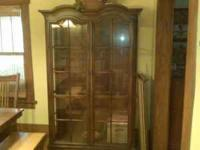 I have a dark wood curio cabinet with glass doors in