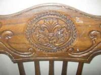 I have 4 wood dining room chairs with beautiful detail.