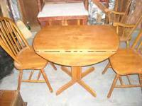Drop leaf dining table with two chairs. James  E-mail