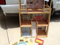 Nice Doll House with furniture in good condition