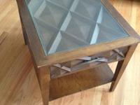 Basic end table with glass top covering a crisscross