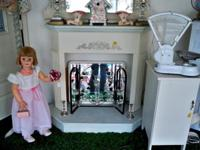 White painted wood fireplace surround. Can be used as