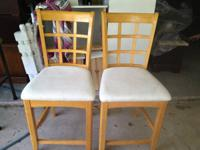 The set of bar stool are with a wood frame and cloth