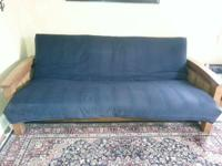Solid wood futon in excellent condition. Not used