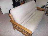Nicer wood frame futon sofa bed. Was $400 new. Has a