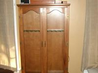 10-gun lighted, wood cabinet with locking glass doors.