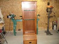 I have a wood gun cabinet. It is made of solid wood and
